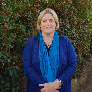 Profile picture of Dr Charmian Bennett standing in garden